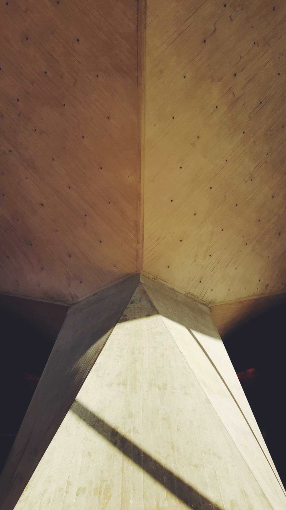 Close-up, abstract view of geometric architecture.