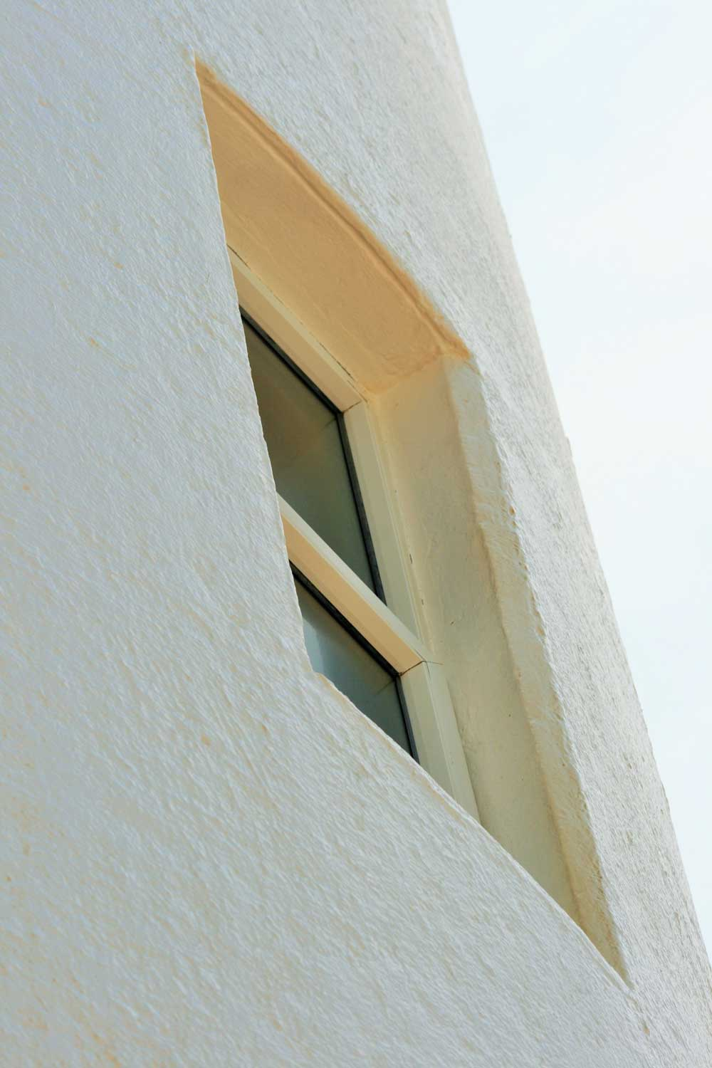 Close-up, angled view of a window on a white building.